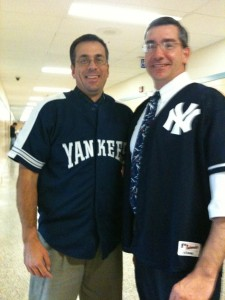 Gary Luft putting on a fake smile after his lossed bet with fellow teacher, Sean McKnight