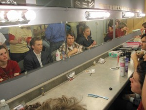"Cast Members of ""Check Please"" get made up, during dress rehearsal."