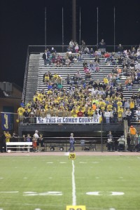 The student section supports the Comets against Hempfield.