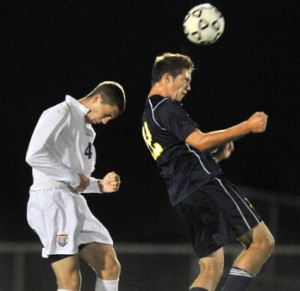 Senior Ben Jennings goes for a header in a match against Conestoga Valley.