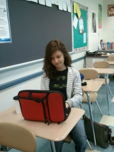 Senior Dezire Diaz uses her 1:1 laptop during homeroom to work on her Open Campus course.